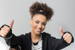 Portrait of african american girl showing thumbs up isolated Stock Images