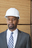 Portrait of an African American male engineer with wooden planks in background Stock Photos