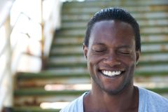 Portrait of an african american man laughing with eyes closed Royalty Free Stock Photography