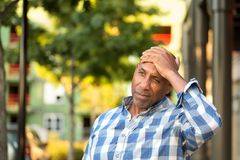 African American man ho.lding his head in pain Stock Photography