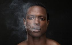 African American Man with Smoke Coming Out Mouth Stock Photos