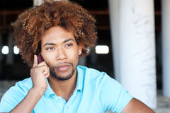 Portrait of African American on phone Stock Image