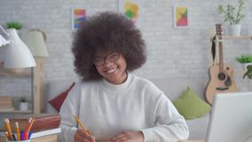 Portrait african american students woman with an afro hairstyle smiling and looking at the camera. Portrait beautiful african american students woman with an stock video footage