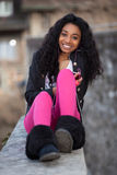 Portrait of african american teenage girl listenin. Outdoor of a portrait happy young african american teenage girl listening to music royalty free stock photos