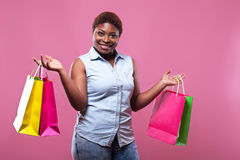 Portrait of African American woman carrying shopping bags agains Royalty Free Stock Photos