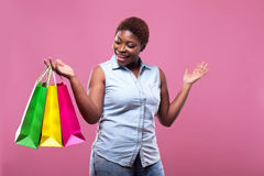 Portrait of African American woman carrying shopping bags agains Royalty Free Stock Images