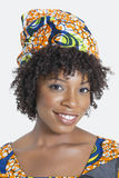 Portrait of an African American woman smiling over gray background Royalty Free Stock Images