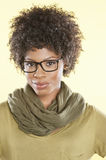Portrait of an African American woman wearing glasses over colored background Royalty Free Stock Photography