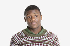 Portrait of an African American young man in sweater over gray background Royalty Free Stock Photos