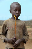 Portrait of the african boy with the burning candle in hands Stock Images