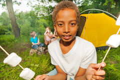 Portrait of African boy who holds marshmallows Royalty Free Stock Photography