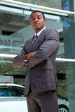 Portrait of an African business man. Outdoor portrait of a confident African business man with his arms crossed Royalty Free Stock Photos