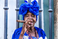 Portrait of african cuban woman smoking cigar in Havana, Cuba Stock Image