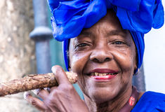 Portrait of african cuban woman smoking cigar in Havana, Cuba Stock Images