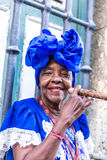 Portrait of african cuban woman smoking cigar in Havana, Cuba Royalty Free Stock Image