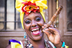 Portrait of african cuban woman smoking cigar and smiling Royalty Free Stock Photos