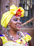 Portrait of african cuban woman smoking cigar and smiling Royalty Free Stock Photography