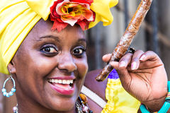 Portrait of african cuban woman smoking cigar and smiling Stock Image