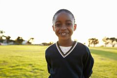 Portrait of African elementary school girl smiling in a park Royalty Free Stock Photography
