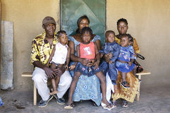 Portrait of an African Family. Outside his home in Ouagadougou stock photos