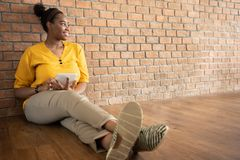 Portrait of African Female Creative Designer in Yellow shirt usi stock photo