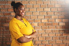 Portrait of African Female Creative Designer in Yellow shirt wit royalty free stock photos