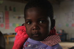 Portrait of an african girl, friends in Swaziland, Africa. An a few years old african girl looking into the camera Royalty Free Stock Image