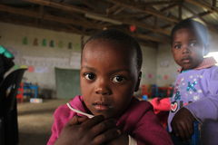 Portrait of an african girl in Swaziland, Africa. An african girl looking into the camera. Sitting in a classroom in rural Swaziland Royalty Free Stock Photo