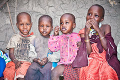 Portrait on an African Kids of Masai  tribe village smiling to t Stock Photo
