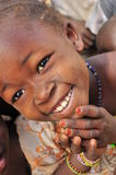 Portrait of african little girl wearing jewlery. Portrait of a beautiful smiling african girl in a village of Niger, West Africa stock images
