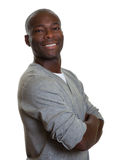 Portrait of an african man in a grey shirt Royalty Free Stock Images
