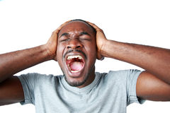 Portrait of african man shouting. And closing ear by his hands on white background Stock Photos