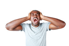Portrait of african man shouting. And closing ear by his hands on white background Stock Images