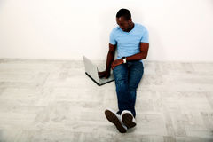 Portrait of african man sitting on the floor Stock Images