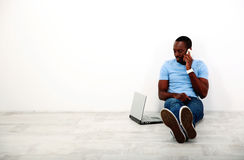 Portrait of african man sitting on the floor Stock Photo
