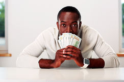 Portrait of african man sitting at the table Royalty Free Stock Images