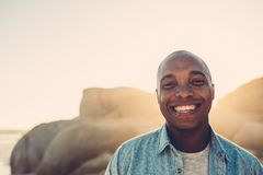 African man smiling on the beach Stock Image