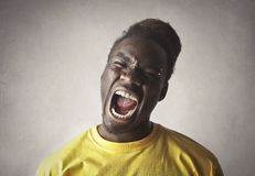 Portrait of an african man screaming Stock Photo