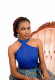 Portrait of African woman in armchair. Stock Photo