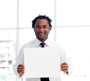 Portrait of an Afro-American businessman holding a Royalty Free Stock Photo