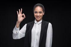 Portrait of afro american businesswoman gesturing ok sign Stock Images