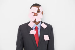Portrait of an Afro businessman covered in blank notes Stock Photography