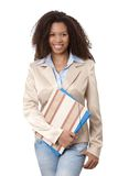 Portrait of afro woman with folders smiling. Portrait of beautiful afro-american woman holding folders, smiling Royalty Free Stock Photography