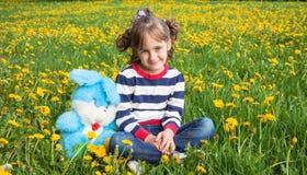 Portrait against dandelions Stock Image
