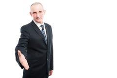Portrait of aged elegant man offering hand shake Stock Photography