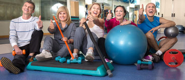 Portrait of aged men and women in top form in modern gym Stock Photography