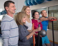 Portrait of aged men and women in top form in modern gym Stock Image