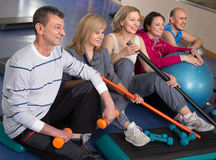 Portrait of aged men and women in top form in modern gym Stock Images