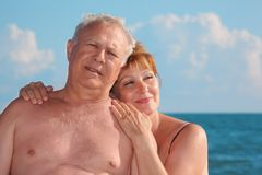 Portrait of aged  pair against sea Royalty Free Stock Image