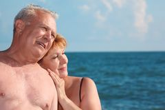 Portrait of aged  pair against sea Stock Photo
